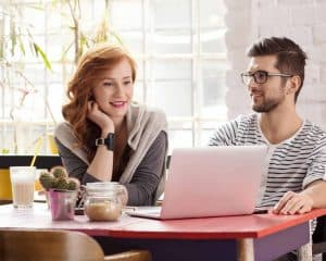 Two people looking at a small business' website