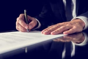A client signing a contract with a lawyer