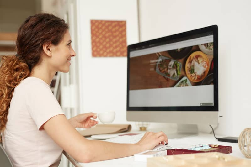 Woman at computer looking at website redesign