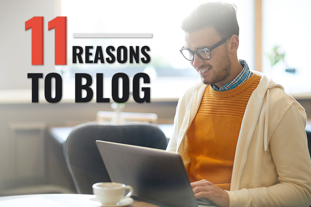 male blogger smiling at laptop with text saying 11 reasons to blog